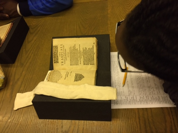 Student reading in Boston Public Library Rare Book and MS Room